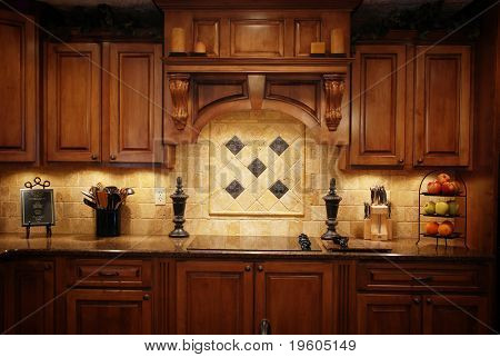 A low light photo of a warm beautiful kitchen