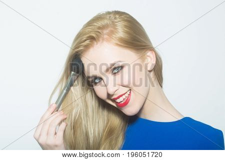 Happy Woman Applying Makeup On Face With Powder Brush