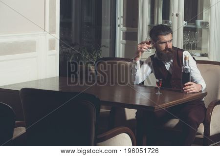 Man Drinking Wine Served With Two Glasses