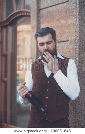 Smoker With Bottle Of Wine Smoking Cigarette