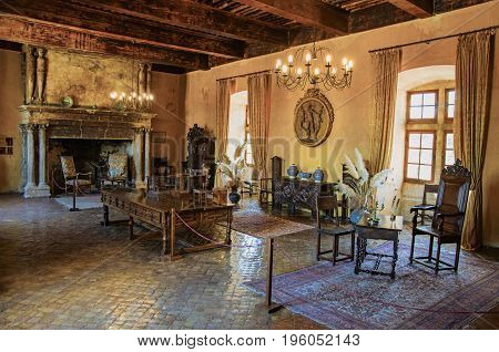 Lourmarin, France - July 07, 2016. Decoration with fireplace in hall in Lourmarin castle. In the Vaucluse department, Provence-Alpes-Côte d'Azur region, southeastern France