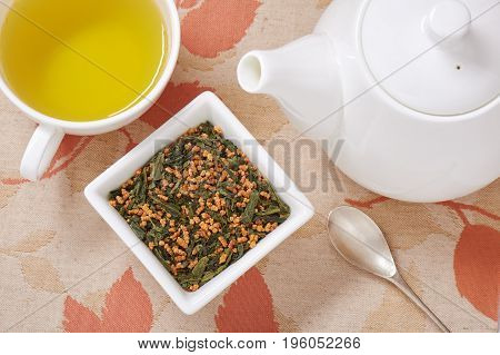 Japanese genmaicha a mix green tea with roasted rice cup of tea and teapot