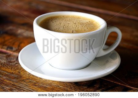 Americano coffee cup on a wooden table