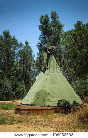 Single native american tipi tent in a camping park