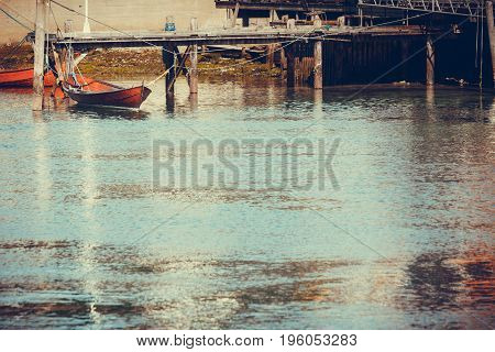 Outdoor Shot Of Old Boat Next To Jetty