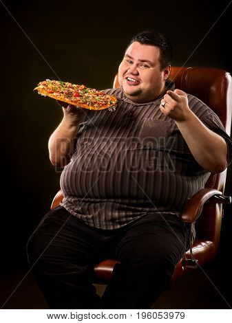 Fat man eating fast food and offers great pizza to customers. Male treats chic junk meal to friends. Breakfast for overweight person. leads to obesity. Tight dinner for a fat man.
