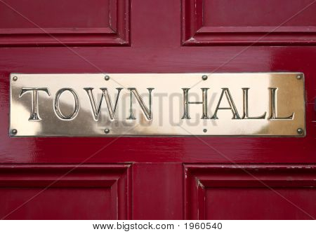 Brass Town Hall Sign On A Door.