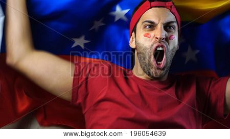Venezuelan Guy Waving Venezuela Flag