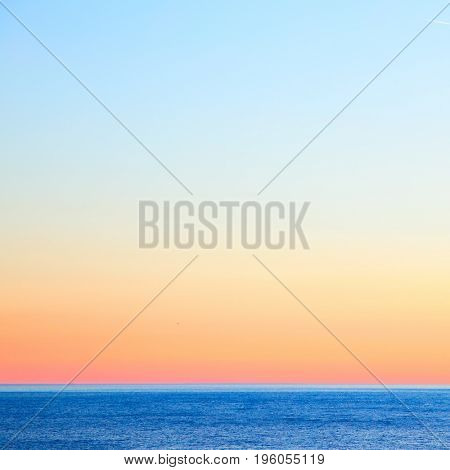 Seascape with sea horizon and colorful clear sky after sundown. Background and space for text