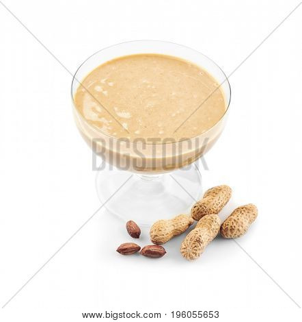 Peanut butter in glass dessert bowl on white background