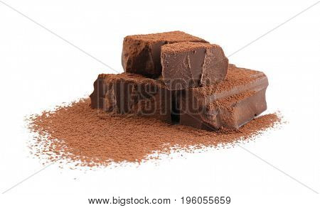 Pile of dark chocolate chunks and cocoa powder on white background