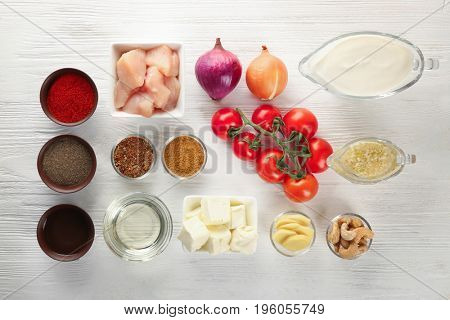 Ingredients for butter chicken on white table