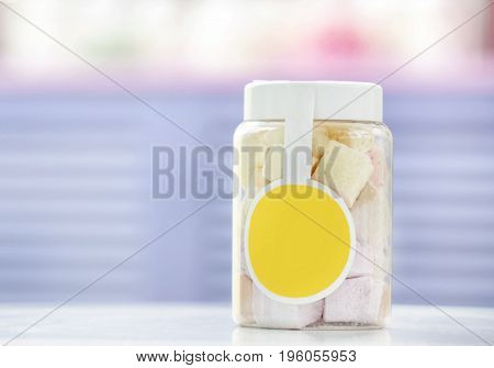 Tasty marshmallow in jar at candy shop