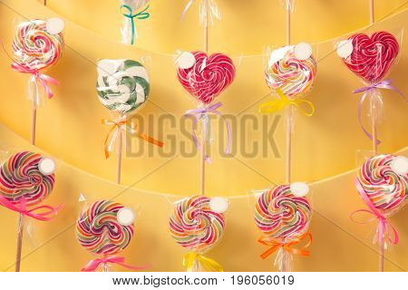 Different lollipops on showcase at candy shop