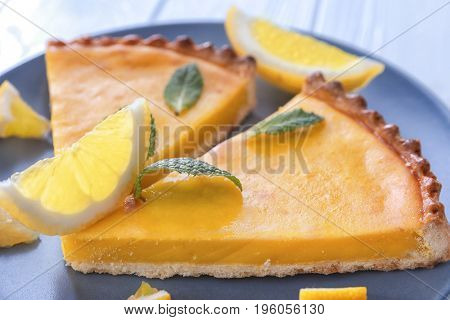 Plate with delicious lemon pie, closeup