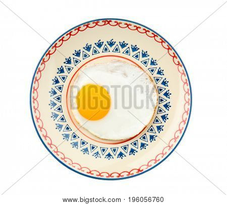 Plate with fried sunny side up egg on white background