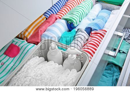 Chest of drawers with clothes and necessities in baby room