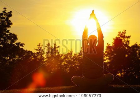 Young man practicing yoga outdoors