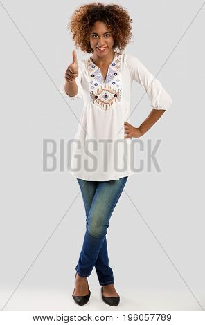 Beautiful African American woman with a thumbs up