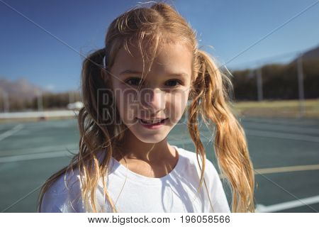 Close up portrait of female tennis player on court