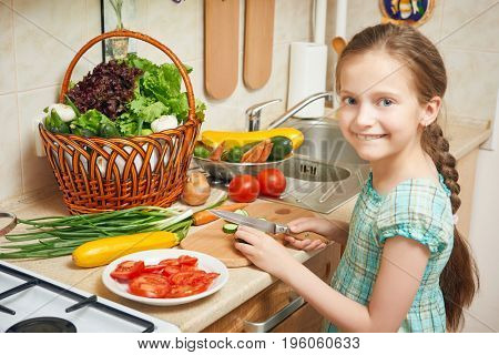 girl in kitchen interior, vegetables and fresh fruits in basket, healthy nutrition concept