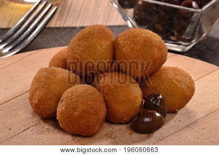 Olive poppers balls sticks and ingredients.