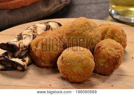 Eggplant poppers balls sticks and ingredients.