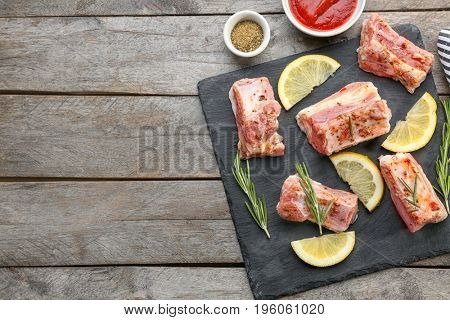 Ingredients for cooking pork ribs on wooden table