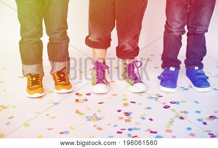 Leg of children party and celebration with confetti
