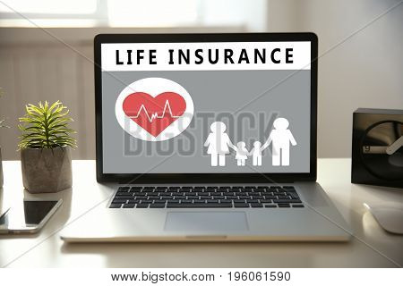 Modern laptop on table. Life insurance concept