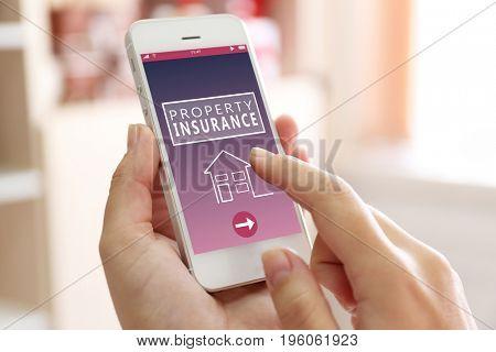 Woman using smartphone, closeup. Property insurance concept