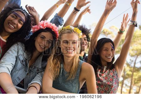 Happy female friends looking away at music festival