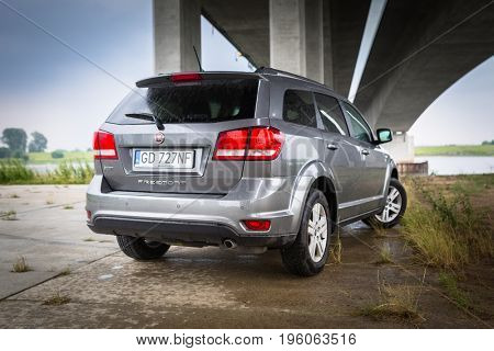 POLAND - JULY 8, 2017:  Fiat Freemont SUV under the highway overpass in Poland. Fiat Freemont is an european version of Dodge Jurney manufactured sience 2011.