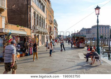 VENICE, ITALY - May 18, 2017.Tourists foot Street in Venice. its entirety is listed as a World Heritage Site, along with its lagoon. VENICE, ITALY.