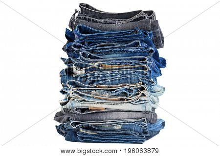 Closeup stack of folded clothes, blue jeans pants texture, dark blue denim trousers showing waistbands