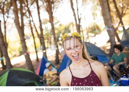 Portrait of cheerful woman with mouth open at campsite