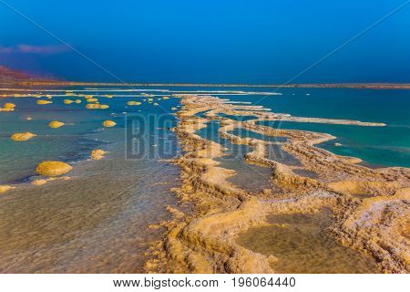 Therapeutic Dead Sea, Israel. Reduced water in the very salty Dead Sea. The concept of medical and ecological tourism