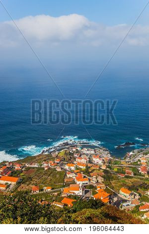 The picturesque resort settlement on the ocean coast. Exotic island in the Atlantic Ocean - Madeira. Concept of exotic and ecological tourism