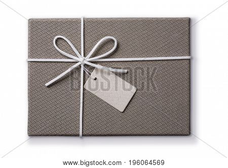 Grey gift box with a tag isolated on a white background
