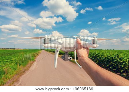 drone in hand for a man on a background the green field