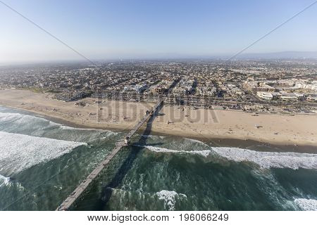 Aerial view of surf at Huntington Beach Pier in Southern California.