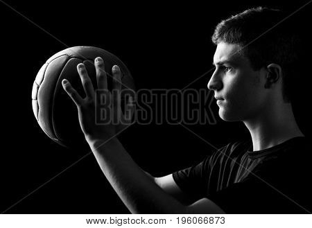young soccer player hold his ball