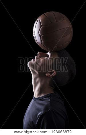 portrait of football player with ball on his head