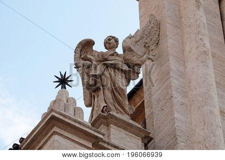ROME, ITALY - SEPTEMBER 01: Angel on the portal of Sant Andrea della Valle Church in Rome, Italy on September 01, 2016.