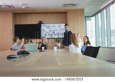 Business entrepreneurs discussing during meeting in board room