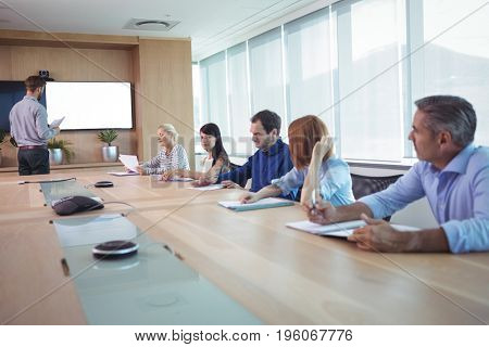Business people at conference table in board room during meeting
