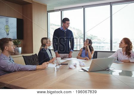 Business partners discussing in meeting at office board room