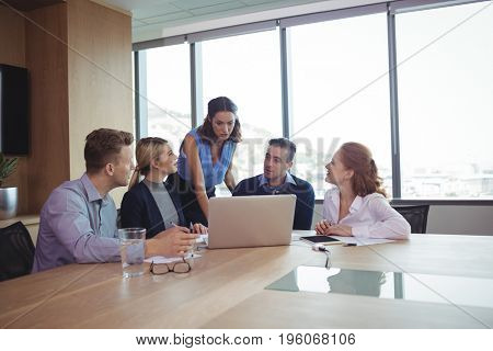 Business people discussing at desk during metting in board room