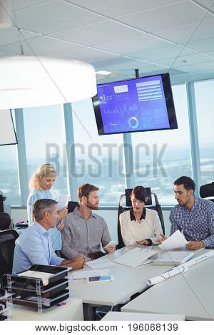 High angle vierw of business partners discussing in meeting at office desk