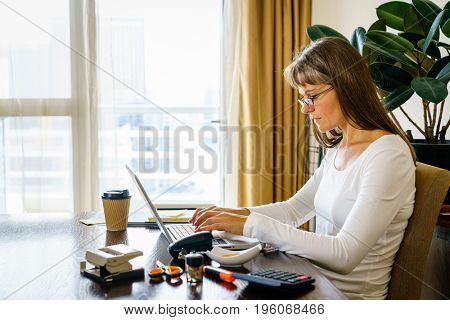 Woman is working in her home office
